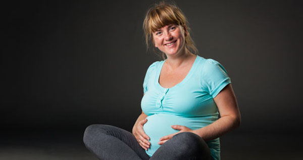 Closeup of a pregnant woman's sitting